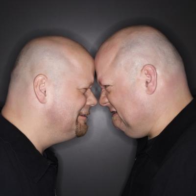 twin men butting heads